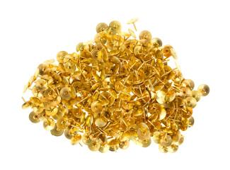 Gold thumbtacks on a white background