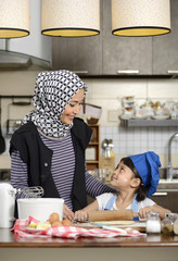 Moslem Woman Teaching Her Daughter