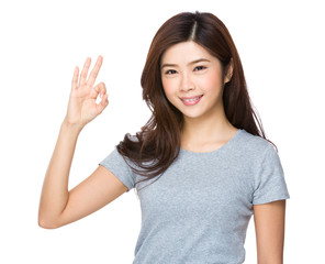 Beautiful young girl showing thumbs up gesture