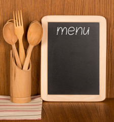 Menu board and wooden spoons and fork