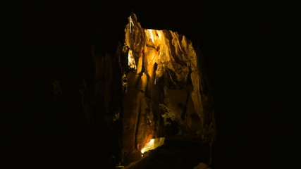 Movement of sun beam in dark cave, Lop Buri, Thailand.