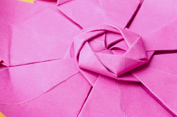 closeup of the intricate pink paper origami flower