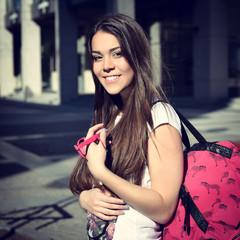 Outdoor portrait of attractive teen girl, toned.