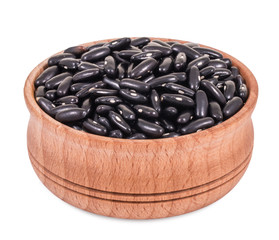 Purple beans in a wooden bowl isolated on white background