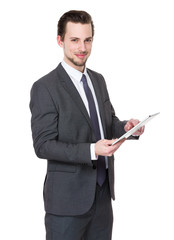 Casual Businessman Looking at a tablet