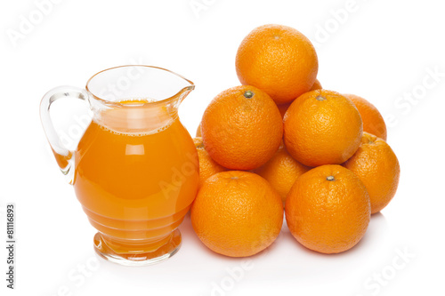 Orange fruit juice in glass jug isolated on white - 81116893