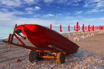 red umbrellas on the beach. Greece, Rhodes