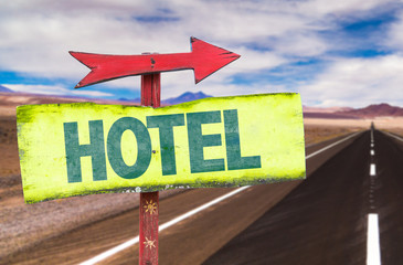 Hotel sign with road background