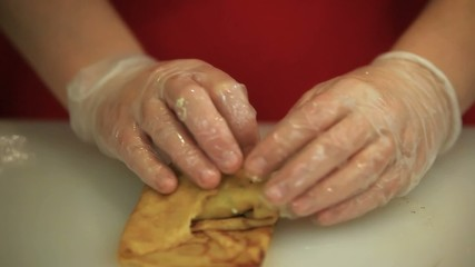 chef women hands cooking boiled eggs with onion filled pancakes