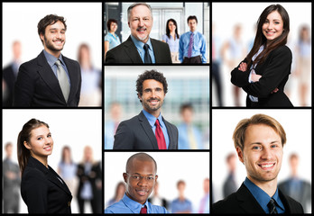 Smiling business people in front of their team