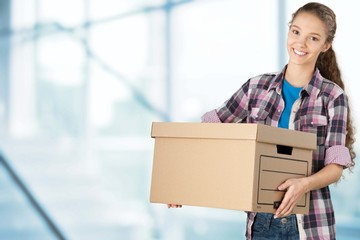 Box. Young woman holding box