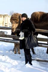 Woman feeding camel