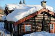 Leinwandbild Motiv Cottage with snow on the roof