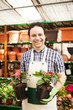 Man holding flower pots