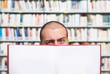 Man holding an open blank book