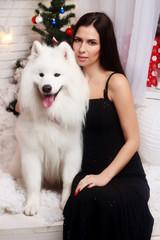 brunette long black dress snow-white dog husky christmas day
