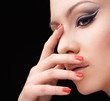 Woman with glamour make up arrow and nail art