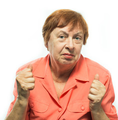The old woman holds fists
