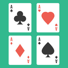 Four aces. Playing cards isolated on green background