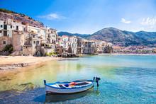 "Постер, картина, фотообои ""Old harbor with wooden fishing boat in Cefalu, Sicily"""
