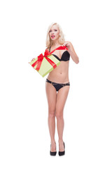 Blonde woman wearing swimsuit holding present