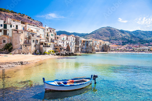 Foto Spatwand Europa Old harbor with wooden fishing boat in Cefalu, Sicily