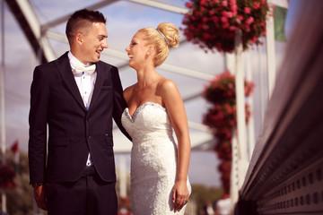 Bride and groom on a metallic bridge