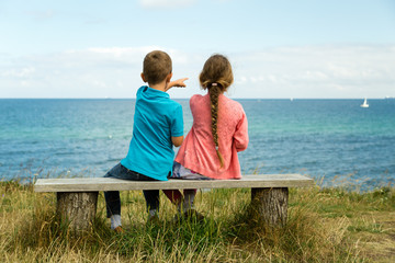 Kids overlooking the ocean