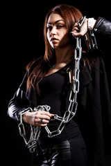 Beautiful young woman with chains