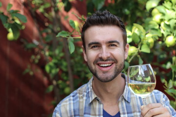 Smiling man holding a glass of wine