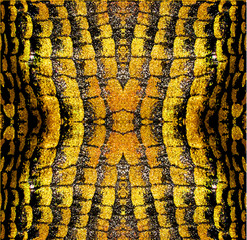 Abstract background of gold and black stylized reptile texture