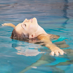 Woman doing water yoga for relaxation