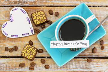 Happy Mother's day card with coffee, chocolates and wooden heart