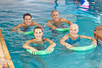 Group of people doing aqua fitness class