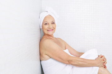 Elderly woman sitting in relaxation room in spa
