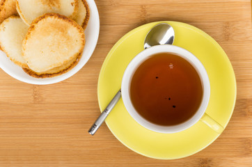 Cup of tea with homemade pancakes
