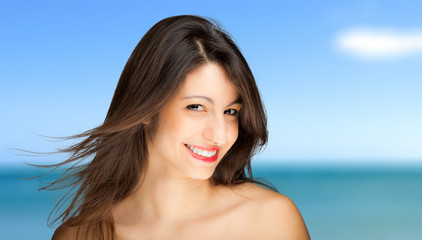 Smiling woman at the sea