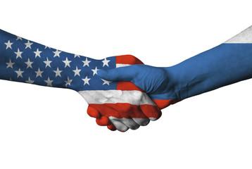 Usa and Russian flag across handshake.
