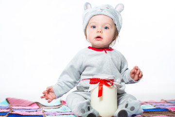 Child with bank of milk