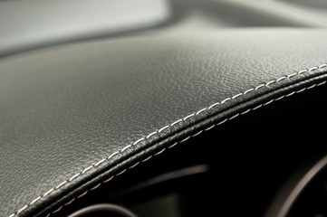 Leather background. Modern business car interior detail.