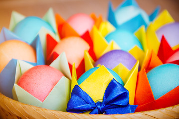 Easter colored eggs in colored wrapper