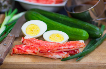 The ingredients to make the salad - crab, cucumber, egg, onion