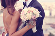 Detail of a bride and groom embracing - 81128244