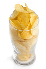 Potato chips poured into a glass