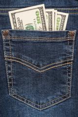 Cash in dark blue jeans pocket closeup