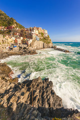 Rock coast of the Cinque Terre National Park, colorful town of M