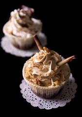 Two Chocolate Cupcakes with walnut and chocolate