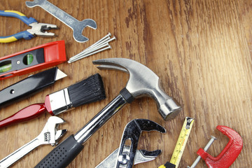 Assortment of work tools on wood
