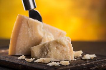 Parmigiano reggiano on wooden background
