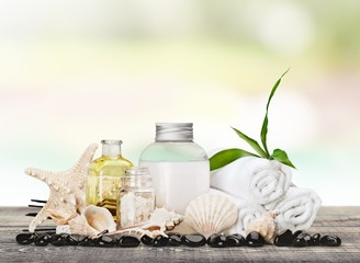 Aromatherapy. Soap bottles composition with shells and incense